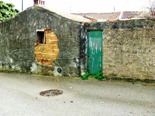 damaged wall buit of mud brick