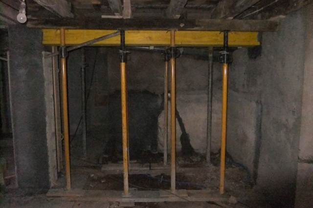 moving wooden beams embedded in walls